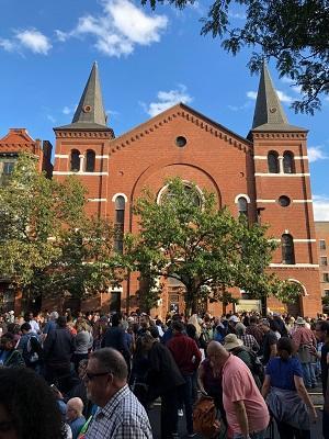 jazz crow stands near church